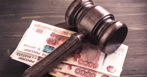 Gavel and some ruble banknotes.Auction bidding, judicial system corruption concept.Toned