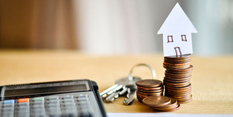 pen and key and calculator and paper house and coins  for Mortgage loans concept